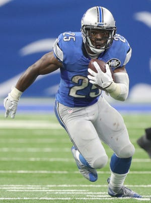Detroit Lions running back Theo Riddick runs the ball against the Tennessee Titans during the home opener Sunday, Sept. 18, 2016 at Ford Field in Detroit.