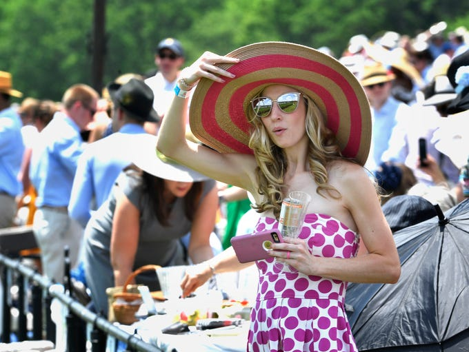 Hats not only kept the sun at bay but gave a stylish