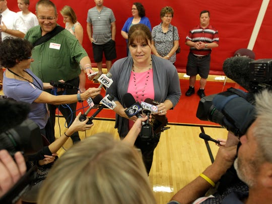 Special education teacher Amy Reed speaks to the media after being named the Wisconsin Special Services Teacher of The Year during a ceremony at Kimberly High School on Thursday, September 3, 2015, in Kimberly, Wis. 