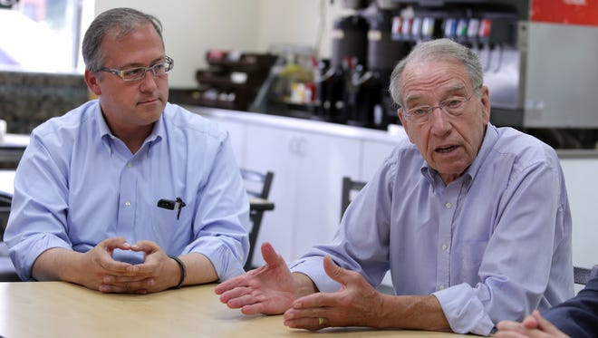 U.S. Sen. Chuck Grassley, right, spent four days in late September and early October campaigning with David Young, who won the 3rd District seat.