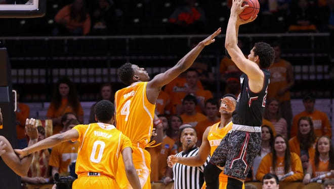 Gamecocks forward Michael Carrera (24) shoots the ball against Tennessee Volunteers forward Armani Moore (4) at Thompson-Boling Arena.