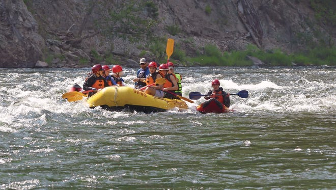 Writer Kit Bernardi's family watches her son, Will, kayak solo for the first time on a Class IV rapid on the Middle Fork of Idaho's Salmon River