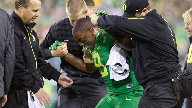 Sep 26, 2015; Eugene, OR, USA; Oregon Ducks wide receiver Byron Marshall (9) is assisted by the training staff following and injury on a punt return against the Utah Utes at Autzen Stadium. Mandatory Credit: Scott Olmos-USA TODAY Sports