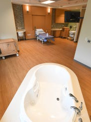 Water therapy tub in one of the labor and delivery
