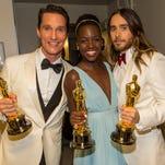 Matthew McConaughey,Lupita Nyong'oandJared Leto show off their Oscar trophies.
