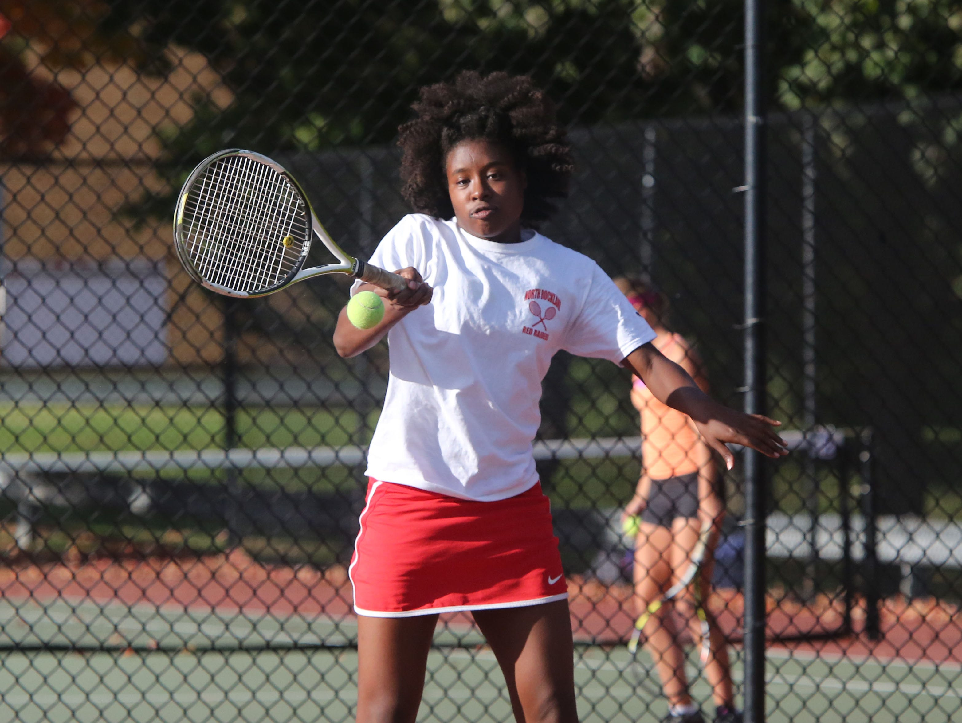 North Rockland's Akemi Dwyer returns the ball while playing with sister Anika Dwyer against Ursuline's Laina Campos and Vanessa Ciano in the doubles finals in the Conference II tennis tournament, Oct. 16, 2015 at White Plains High School.