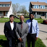 Abdur Rasheed Vanzant, 52, of Detroit with his wife Taqwa Vanzant, right, and daughter Shakeelah Vanzant, 24, standing in front of one of the completed houses on Waverly Street on Friday, May 22, 2015 in Detroit.