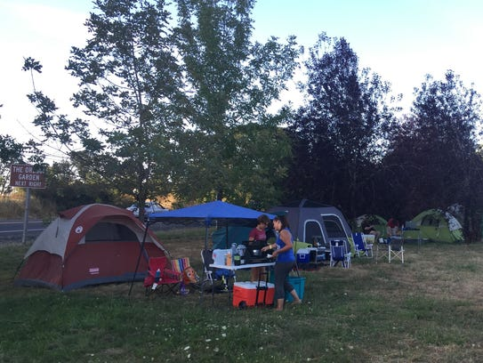 A handful of campers begin to setup at the Oregon Garden