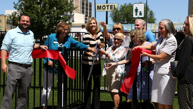 Local dignitaries and donors participate in the ribbon cutting ceremony at the new Biggest Little City Dog Park in downtown Reno on July 10, 2018.