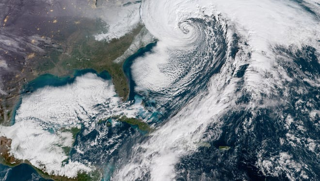A GOES satellite image of a powerful winter storm that formed Wednesday off the coast of Florida and raced up the East Coast.
