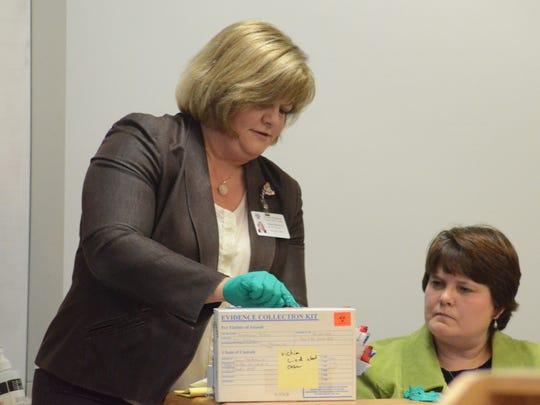 Michelle Richardson questions Timira Perry, a sexual assault nurse examiner, about contents of a rape kit.