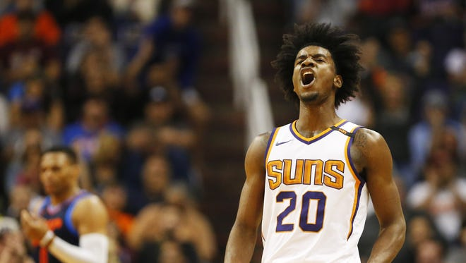 Phoenix Suns forward Josh Jackson (20) celebrates after a 3-point field goal against the Oklahoma City Thunder during the fourth quarter at Talking Stick Resort Arena in Phoenix January 7, 2018.