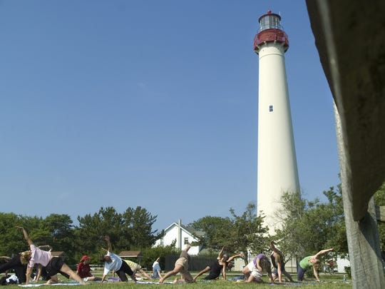 Yoga is popular at the Cape May Point Lighthouse, also a great area to ride your bike.