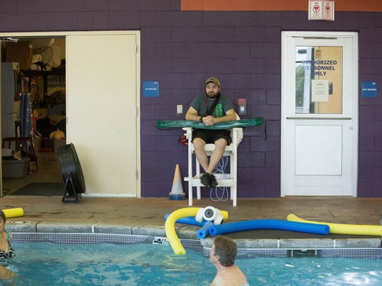 Jerrod Riley, head lifeguard at the Las Cruces Regional Aquatic Center, keeps on eye on swimmers on April 30.