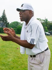 """Reggie McKenzie shouts from the sidelines, yelling """"Hustle! Hustle! Hustle!"""" while watching football players practice during the Reggie McKenzie football camp in Highland Park on Tuesday, July 11, 2017.  McKenzie founded the annual camp, which is now in its 44th year."""