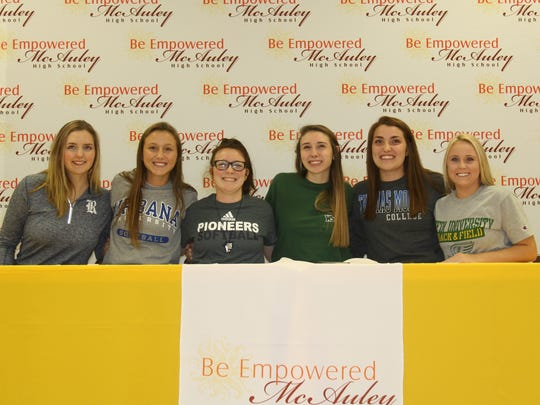 Signing day at McAuley on Nov. 9. From left: Lexi Chrisman (Rice, basketball), Britney Bonno (Urbana, softball), Meghan Gabriel (Malone, softball), Celia Powers (Wright State, volleyball), Carlee Lambert (Thomas More, volleyball) and Cam Barnett (Tiffin, track and field).