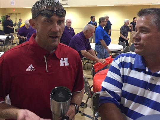 Haughton coach Jason Brotherton visits with Parkway athletic director Rick Bryant during the 64th Bossier Lions Club Jamboree coaches dinner.