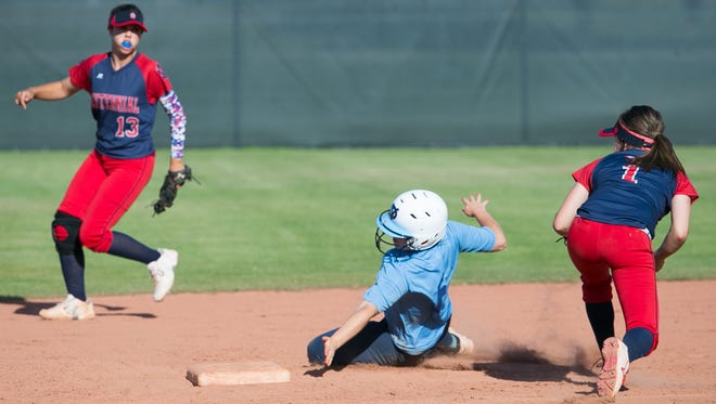 Deer Valley's Marlee Pieper dodges  Centennial infielder Skylar McCarty's tag as she steals second base during a game.