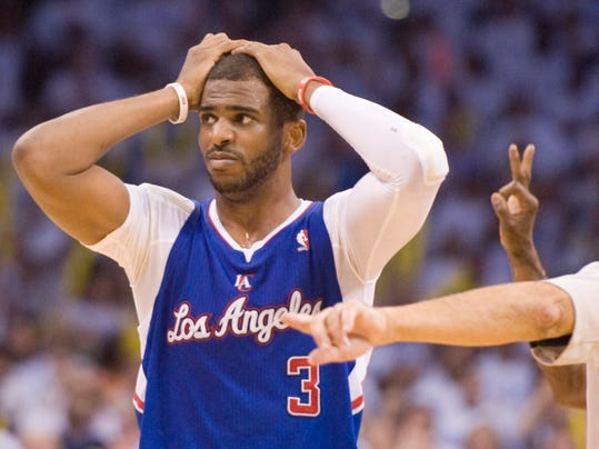 Los Angeles Clippers' guard Chris Paul can't believe they officials called a foul as Oklahoma City Thunder's guard Russell Westbrook  shooting a 3-point shot during the second half in Game 5 of the NBA Western Conference semi-finals at the Chesapeake Arena in Oklahoma City on Tuesday, May 13, 2014. (AP Photo/The Orange County Register, Michael Goulding) ///ADDITIONAL INFO.01.clippers.0514.mg- 05/13/2014  - MICHAEL GOULDING, ORANGE COUNTY REGISTER -  Clippers v Thunder Game 5 Western Conference semi-finals