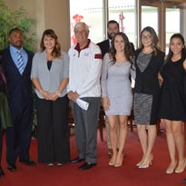 To honor the Aggie Pride Call Center's top student callers, New Mexico State University President Garrey Carruthers joined them for lunch on Nov. 13 at the Third Floor Bistro. From right to left are Adrian Bautista, assistant director of annual giving; Crystal Hernandez, Deontae Ragas and Krysta Klimaj, student callers; Carruthers; Loren Maybrier, call center manager; and Anais Chavez, Sheila Quintana, Marisa Rodriguez and Jonathan Gordon, student callers.