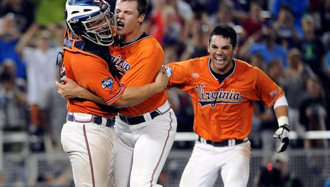 Virginia Cavaliers pitcher Nathan Kirby (middle) hugs catcher Matt Thaiss (left) after the game against the Vanderbilt Commodores in game three of the College World Series Final