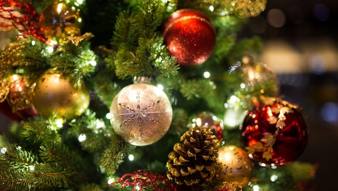 Decorating the tree and other holiday traditions are good for your family.