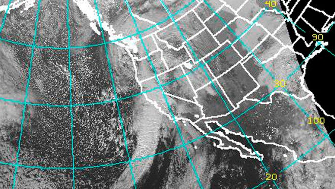 """This Dec. 11 satellite imagery from the National Oceanic and Atmospheric Administration shows the """"Pineapple Express,"""" a storm front extending from west of Hawaii and aimed directly at California, bringing strong gales and sheets of rain that knocked out electricity, flooded freeways and toppled trees in Northern California on Thursday.  Slide-prone Southern California was bracing for its own beating later Thursday evening and Friday morning. This """"Pineapple Express"""" storm blowing down the coast was unusual not only for its force, but for the warmth it brought to San Francisco, which was a balmy 60 degrees, about 5 degrees above average for this time of year."""