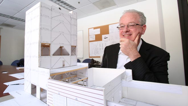 David Sudolsky, president and CEO of Anellotech, is seen on Jan. 30 with a model of a proposed expansion at their building on the Pfizer campus in Pearl River.