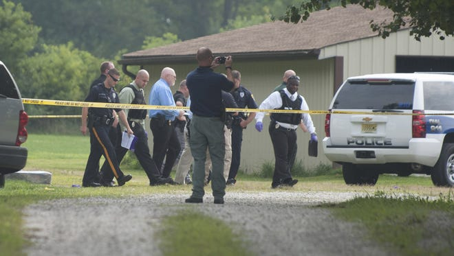 Officials investigate an incident on New Freedom Rd. in Winslow Twp. where a police officer shot a man in the torso and head, according to reports.  Friday, August 1, 2014.