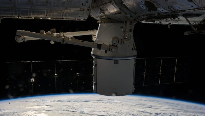 The unmanned SpaceX Dragon capsule berthed at the International Space Station Sunday April 20, 2014.