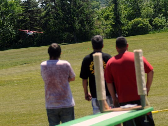 Spectators and pilots watch an RC plane Sunday, June 12, during the Brown City Days Soybean Festival.