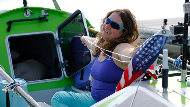 American rower Sonya Baumstein, from Orlando, Fla., sits on her boat as she prepares to leave Choshi Marina in Choshi, a port east of Tokyo, headed for San Francisco Sunday, June 7, 2015.