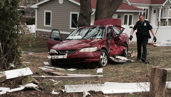 A car ended up in a front yard after a two-car accident on Bradhurst Avenue and Thomas Place near Blythdale Children's Hospital in Valhalla, April 14, 2015.