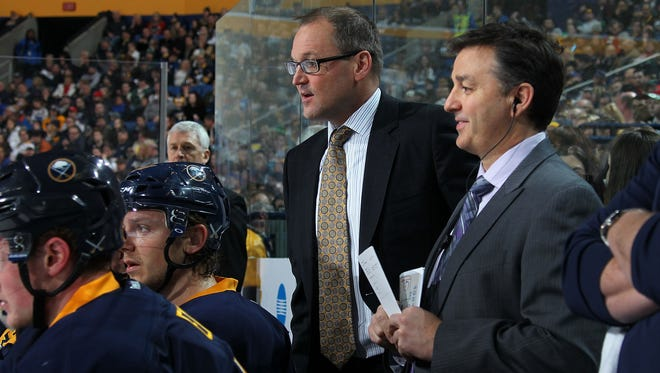 Dan Lambert, foreground, spent the past season as assistant coach to Sabres head coach Dan Bylsma. He was announced as Amerks head coach on Monday.