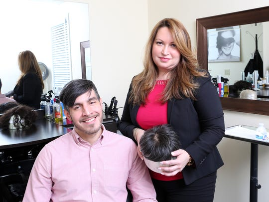 Flora Fuentes, owner of Unique Hair Concepts in Ardsley, with client Michael Perlaza of Manhattan, May 4, 2017. Perlaza, 41, wears a hair and scalp prosthetic that was created with the help of 3D technology to replicate the scalp.