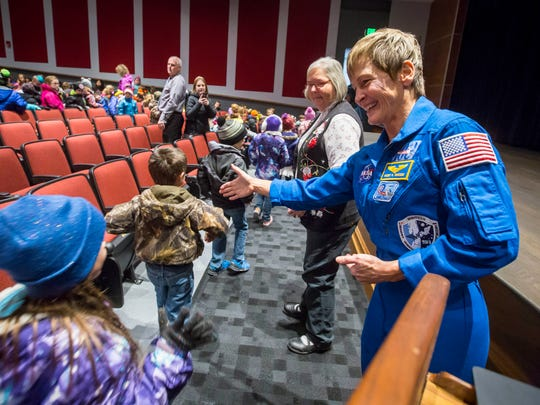 Peggy Whitson, astronaut, greets students after speaking to elementary students at Mt. Ayr High School Auditorium Thursday, Dec. 7, 2017, in Mt. Ayr, Iowa.