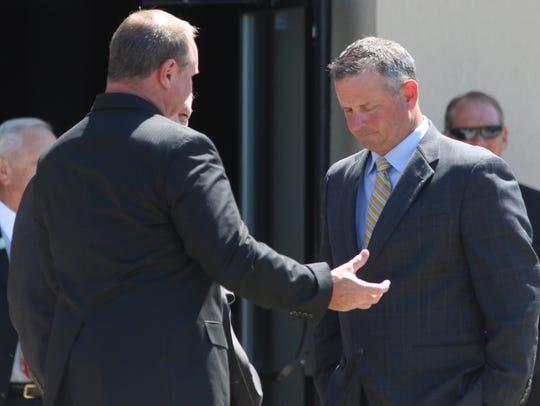 Montgomery County Chief of Staff Jeff Truitt, left,