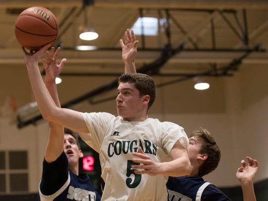Colts Neck's Dan Gaines goes up with shot during first