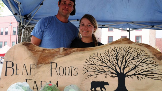 Jon Wagner and Karin Bellemare of Bear Roots Farm in South Barre at the first day of the Burlington Farmers Market Saturday in City Hall Park. This is the first year for Warner and Bellemare at the market.