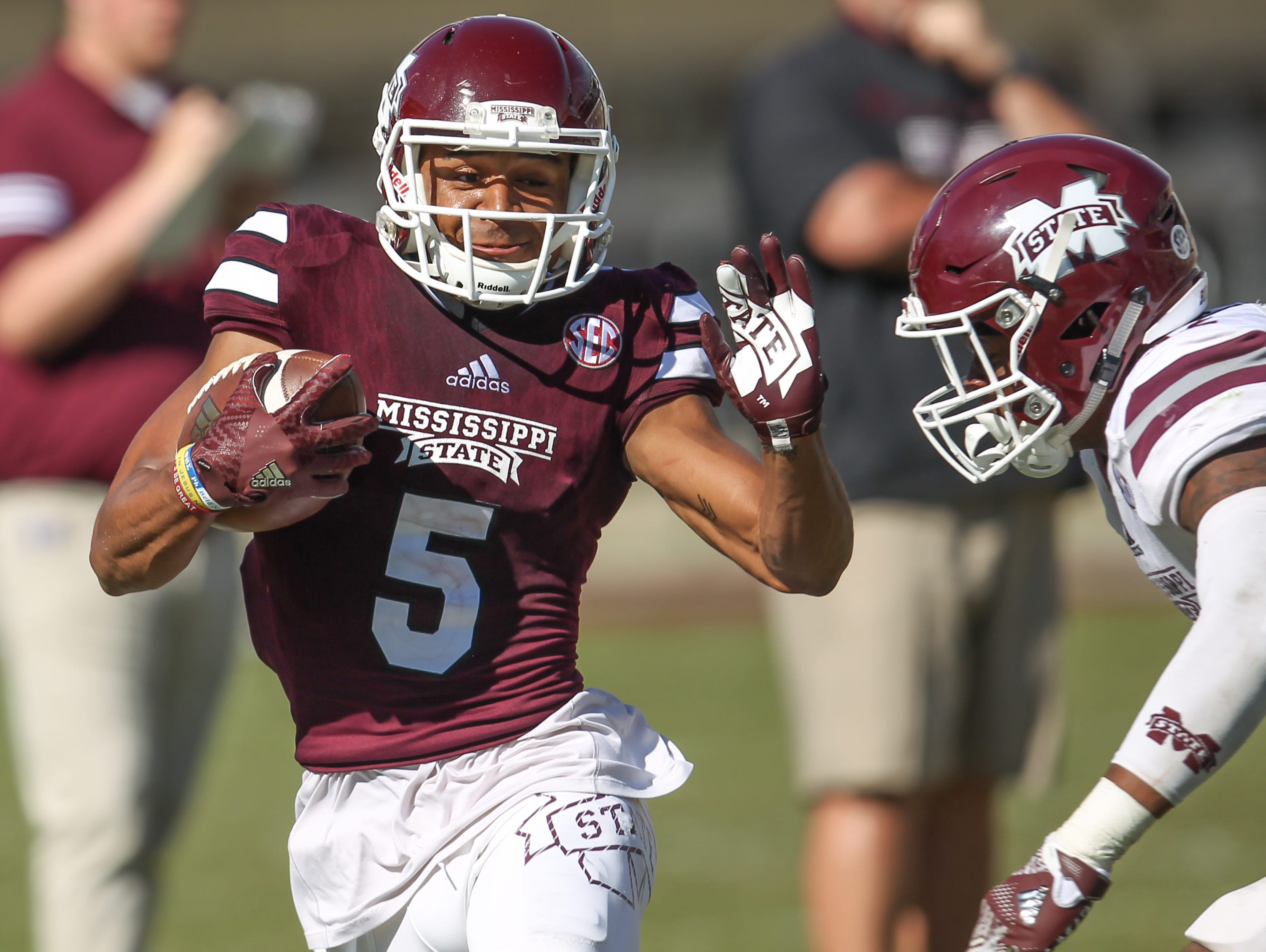 Gabe Myles (5) runs for extra yards after catching a pass in Mississippi State's Maroon and White Spring Football Game.