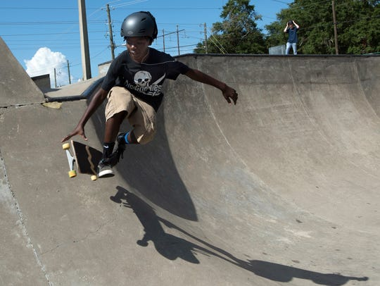 Cedarius Johnson practices his skating skills Thursday at the Steven Morgan Skate Park in Milton. Milton City Councilman Jeff Snow wants the city to change an ordinance to allow bicycles to use the skate park.