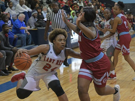North Caddo's Destiny Rice moves the ball in their