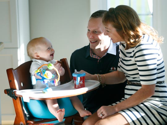 Pat and Kelly Coleman get a smile from their 10-month old son Evan at their Victor home.
