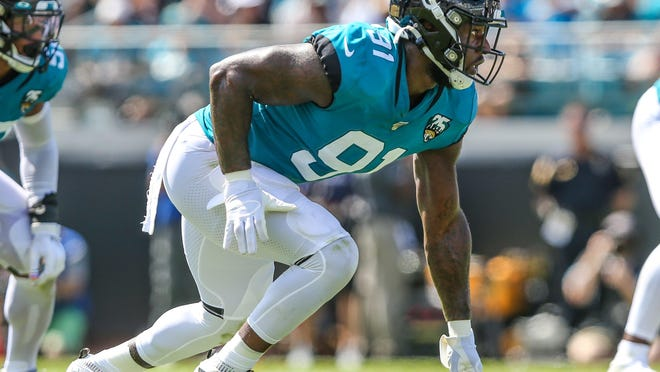 Jaguars defensive end Yannick Ngakoue fires off the line against the Saints in 2019. Ngakoue's long-term status with the team is still uncertain.