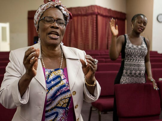 Theresa Wento prays for an end to the deadly Ebola virus that is ravaging parts of Africa and that has now spread to the United States; she prays for the victims and for the health of those not yet infected during the Sunday Ebola Prayer Service at the African Faith Expressions Church Oct. 12, 2014 in Phoenix.