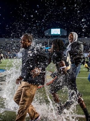 Alabama State interim head coach Donald Hill-Eley is dunked with water after defeating Alabama A&M in the Magic City Classic at Legion Field in Birmingham, Ala. on Saturday October 27, 2017. (Mickey Welsh / Montgomery Advertiser)