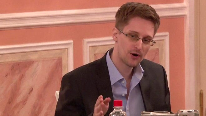 A frame grab made from AFPTV footage, reportedly taken on Oct. 9, 2013, shows U.S. intelligence leaker Edward Snowden speaking during his dinner with a group of four retired U.S. ex-intelligence workers and activists at a luxurious room in an unidentified location.