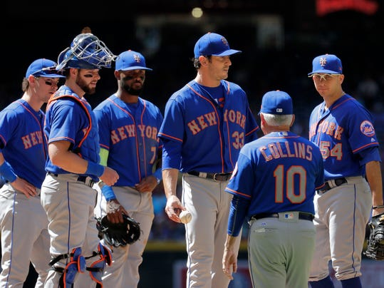 New York Mets starting pitcher Matt Harvey (33) is pulled from the game by manager Terry Collins (10) during the sixth inning of a baseball game against the Arizona Diamondbacks, Wednesday, May 17, 2017, in Phoenix. (AP Photo/Matt York)