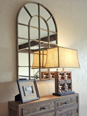 When shopping for a mirror, choose one that complements the furniture and is properly sized.
