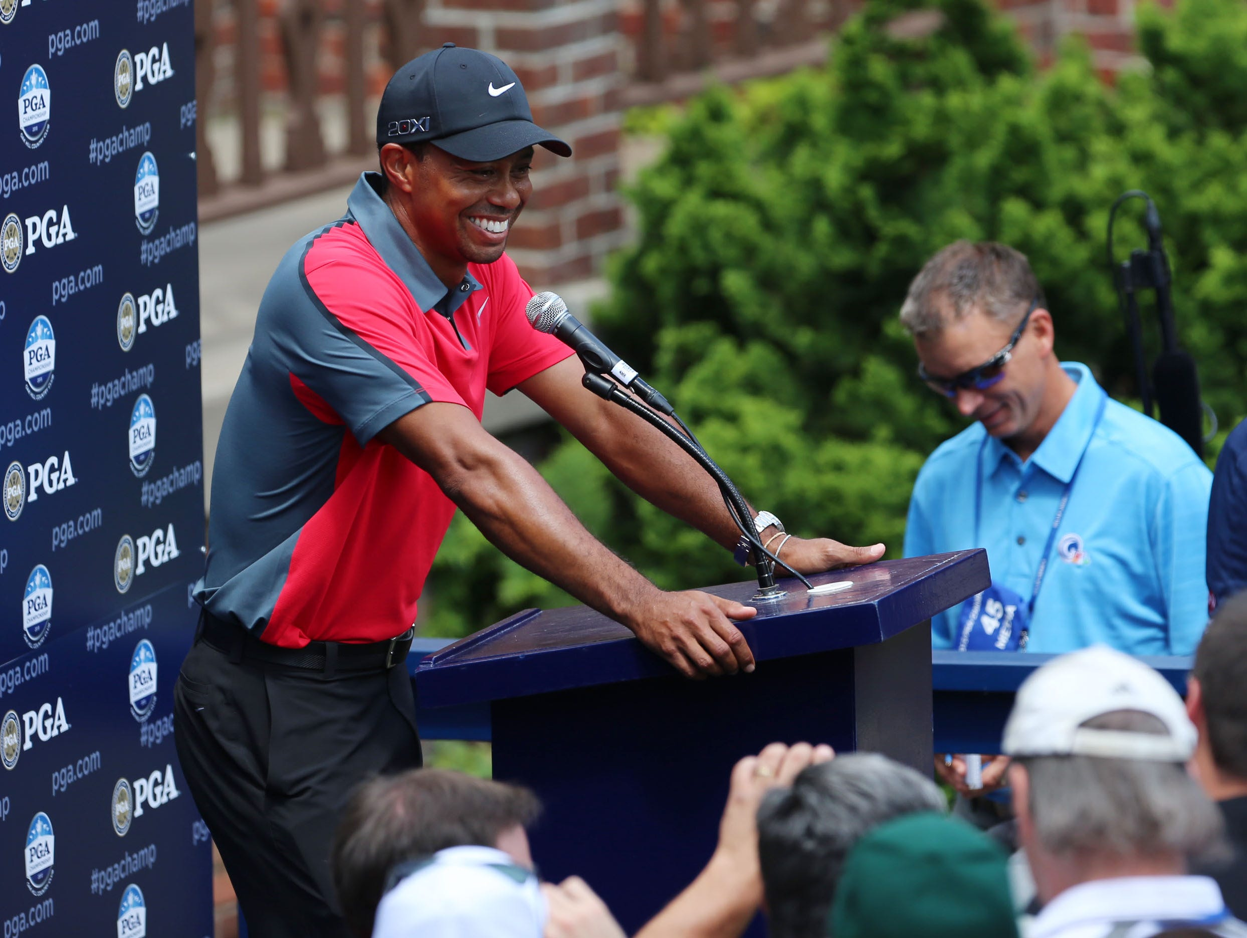 Tiger Woods talks to the media after his final round.